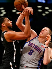 Brooklyn Nets center Jahlil Okafor (4) and Detroit Pistons forward Henry Ellenson (8) battle for a rebound during second half at Barclays Center.