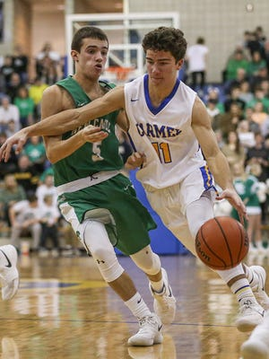 Carmel guard Luke Heady (11) averages 8.4 points a game for the Greyhounds.