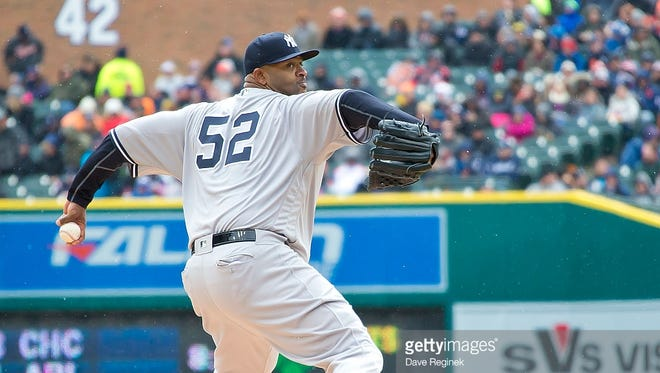 Starting pitcher CC Sabathia #52 of the New York Yankees throws in the second inning during a MLB game against the Detroit Tigers at Comerica Park on April 9, 2016 in Detroit, Michigan.