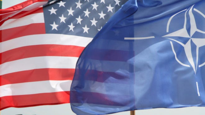 The U.S. and NATO flags