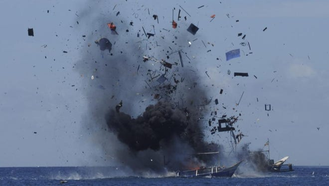 The Indonesian navy blows up foreign boats caught fishing illegally in Indonesian waters on May 20, 2015.