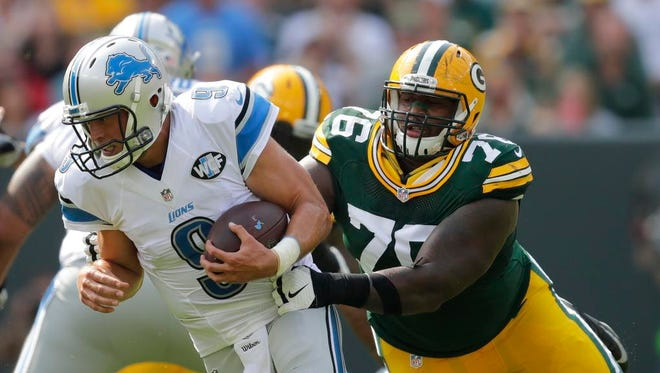 Green Bay Packers defensive end Mike Daniels pressures Detroit Lions quarterback Matthew Stafford in the first quarter.