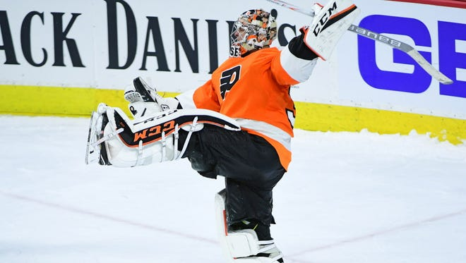 Flyers goalie Steve Mason (35) celebrates after making a final save during the shootout against the Bruins.