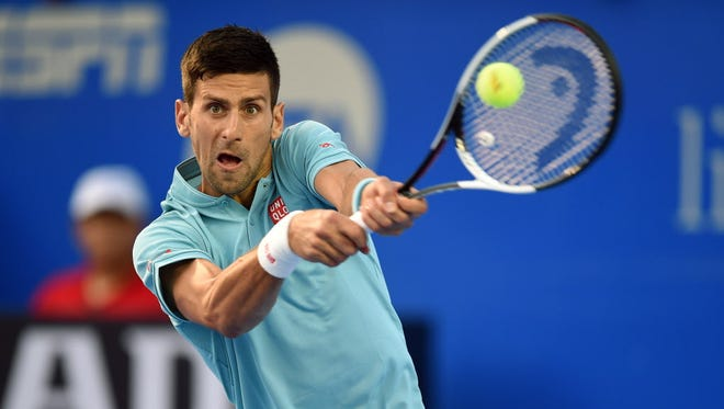 Novak Djokovic returns the ball during his match against Martin Klizan on the second day of the Mexican Open.