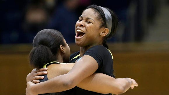 Oregon's Ruthy Hebard, right, hugs Oti Gildon following a second-round game against Duke in the NCAA women's college basketball tournament in Durham, N.C., Monday, March 20, 2017. Oregon won 74-65. (AP Photo/Gerry Broome)