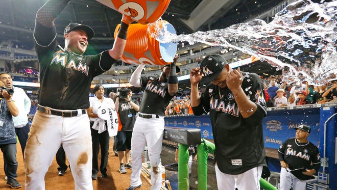 Teammates dump ice water on Edinson Volquez after he pitched a no-hitter in the Marlins' victory over the Diamondbacks on Saturday.