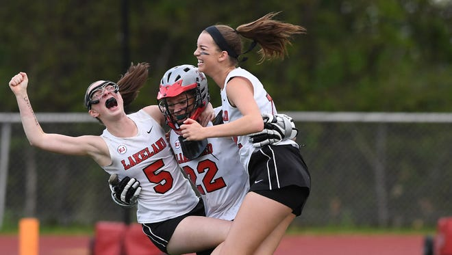 Lakeland's Sarah Deighan (center) celebrates with teammates after helping to lead the Lancers to the Passaic County girls lacrosse championship. Deighan also won a county title in soccer and reached the county final in basketball.
