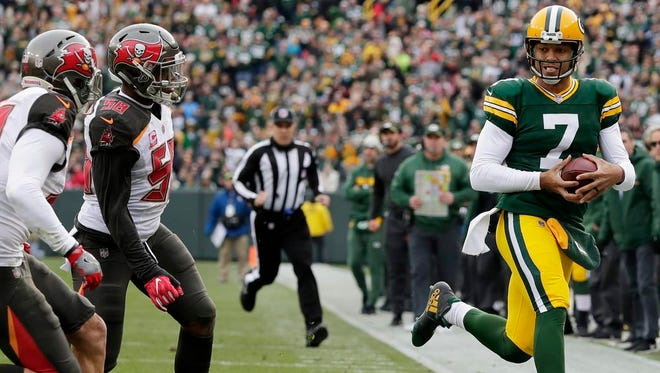 Green Bay Packers quarterback Brett Hundley (7) scrambles out of bounds against the Tampa Bay Buccaneers in the second quarter at Lambeau Field on Sunday, December 3, 2017 in Green Bay, Wis.