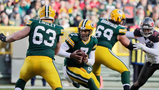 Green Bay Packers quarterback Brett Hundley (7) scrambles against the Tampa Bay Buccaneers in the third quarter at Lambeau Field on Sunday, December 3, 2017 in Green Bay, Wis.