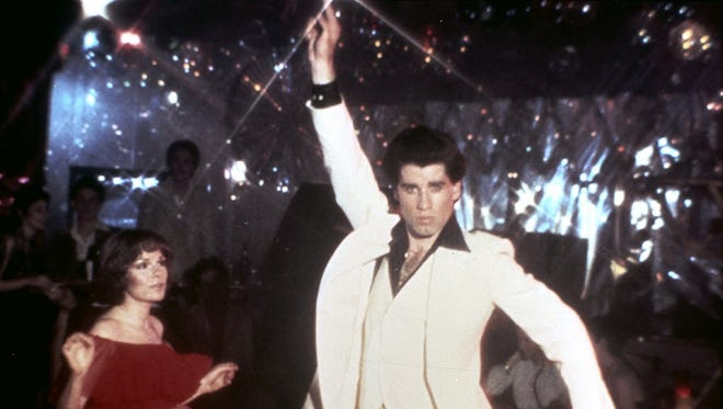 John Travolta (with Karen Lynn Gorney) struck a pose and set off the disco dance craze in 1977's 'Saturday Night Fever.'