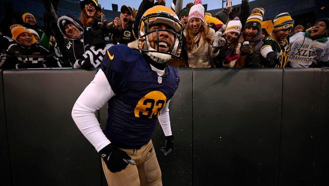 Micah Hyde is all smiles after getting doused with beer during his Lambeau Leap, which followed a 75-yard punt return touchdown.