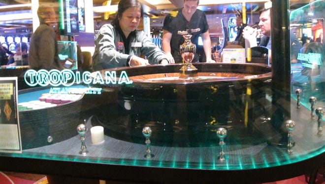 This Jan. 31, 2018 photo shows a dealer conducting a game of roulette at the Tropicana casino in Atlantic City N.J. Having lost its casino license a decade ago after former owners made drastic cuts that left it filthy, understaffed and losing customers, the Tropicana under the ownership of billionaire investor Carl Icahn has become the No. 2 casino in Atlantic City in terms of overall gambling revenue, trailing only the Borgata. (AP Photo/Wayne Parry) ORG XMIT: RPWP103