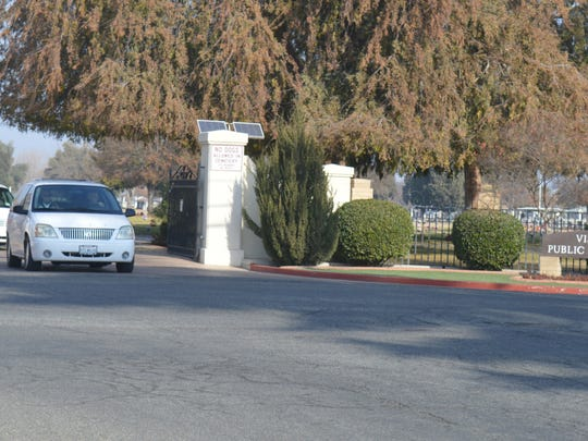 A car drives near the Visalia cemetery's entrance on Wednesday. Former district manager Dona Shores may face additional embezzlement charges
