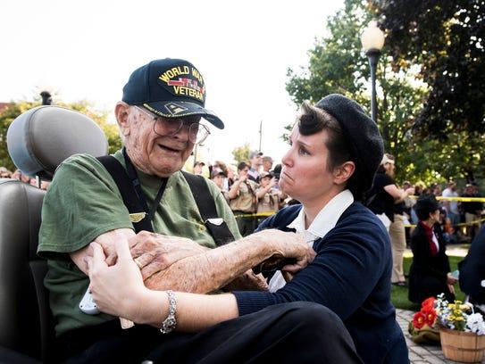 Amanda Charlton comforts Lawrence Bolin, 94, after