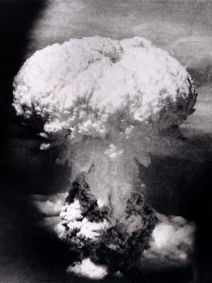A massive column of billowing smoke, thousands of feet high, mushrooms over Nagasaki, Japan, after the United States dropped an atomic bomb on Aug. 9, 1945. A B-29 plane delivered the blast killing approximately 70,000 people, with thousands dying later of radiation effects. The attack came three days after the U.S. dropped the world's first atomic bomb on the Japanese City of Hiroshima. The attacks brought about Japan's unconditional surrender, and the war ended when the papers of surrender were accepted aboard the U.S. battleship Missouri on Sept. 2, 1945.
