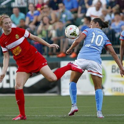 WNY's Samantha Mewis, left, battles Houston's Carli