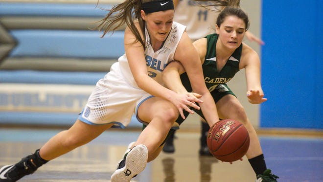 South Burlington's Emma MacDonough, left, and St. Johnsbury Academy's Allison Brink chase down a loose ball in South Burlington on Friday.