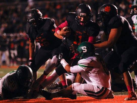 Aztec's Cody Smith scores a touchdown against Farmington