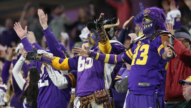 Minnesota Vikings fans cheer against the New Orleans Saints during the second quarter in the NFC Divisional Playoff football game at U.S. Bank Stadium.