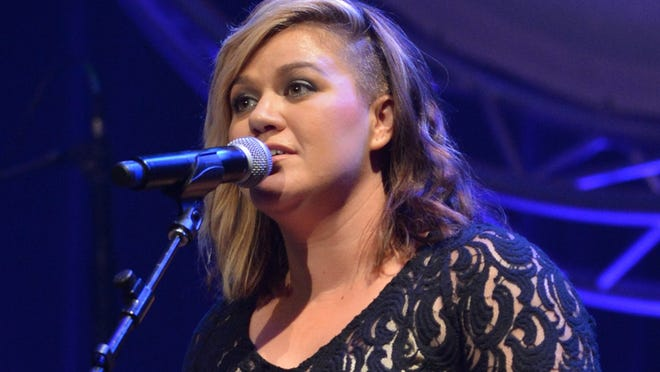 NASHVILLE, TN - SEPTEMBER 09:  Kelly Clarkson performs at the 8th Annual ACM Honors at the Ryman Auditorium on September 9, 2014 in Nashville, Tennessee.  (Photo by Jason Davis/Getty Images for ACM)