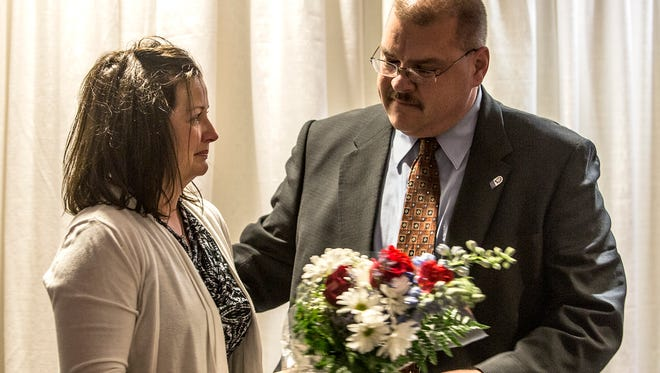 Marty Snavely was awarded the the Extraordinary Personal Action award for donating her kidney in 2014 to then Newark Police Captain Steve Baum. Baum, who was appointed police chief last year, died recently from a medical emergency.