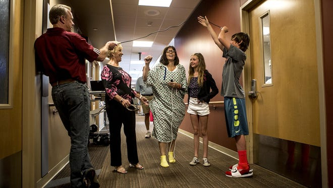 Stacey took her second walk through the hospital hallways when her family came to visit. As she neared her room, Darin and Noah ran ahead to hold a finish line up to encourage Stacey.