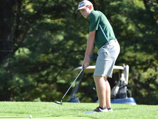 Wilson Memorial's Jacob Sears putts from the fringe