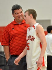 Jim Jacobsen chats with a Sussex Hamilton JV basketball player during his days at HHS.