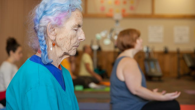Rainbow Cornelia, 80 of Burlingon, does yoga at the Turning Point Center, Monday in Burlington.