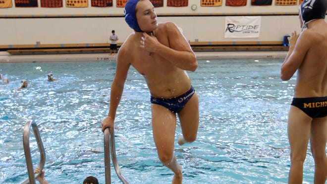 Kyle Dedert hops out of the pool during practice at Rockford High School.