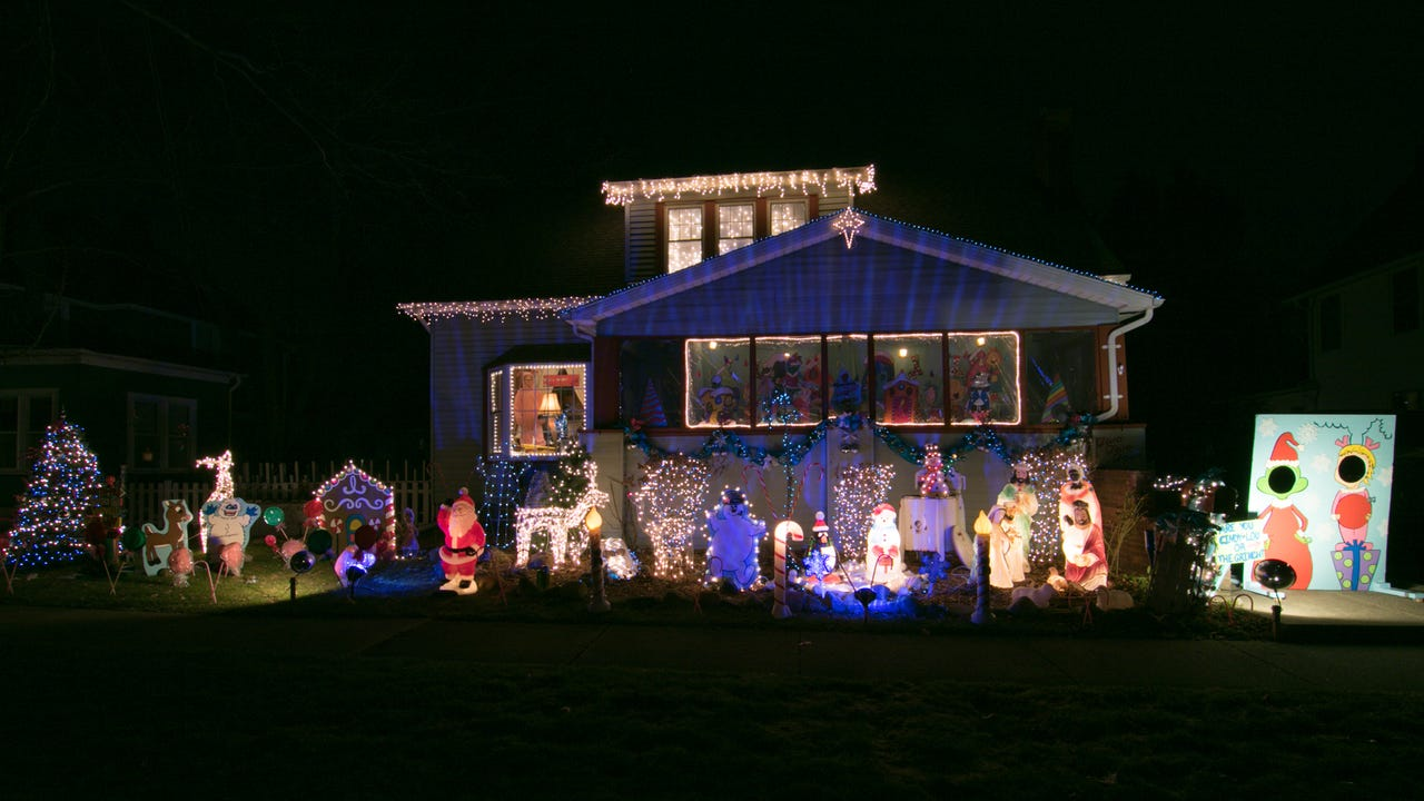 A houseful of Christmas trees and animated light display synced to music playing in the front yard make Karen Berry's house extra festive.