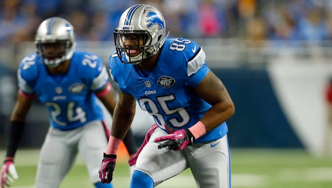 Detroit Lions tight end Eric Ebron looks to block against the Buffalo Bills on Oct. 5, 2014.