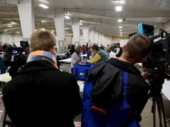 Amid high media attention recount workers with Ingham