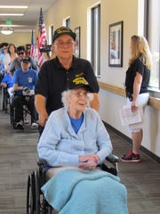 Deloris Lukens, a Navy veteran of World War II, rides the down hallway at the Southern Utah Veteran's Home in Ivins City, in advance of the first-ever Flightless Flight.