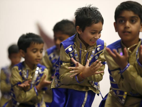 Children perform a medley Punjabi mix for the Diwali celebration at Hindu Temple Gujarati Samaj.