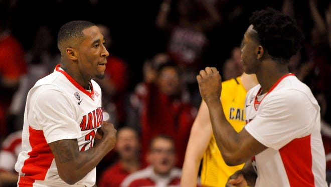 Mar 5, 2015: Arizona Wildcats forward Rondae Hollis-Jefferson (23) and forward Stanley Johnson (5) celebrate during the first half against the California Golden Bears at McKale Center.