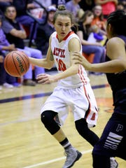 Aztec's Elana Kresl drives to the basket during a game against Piedra Vista on March 4 at Lillywhite Gym in Aztec.