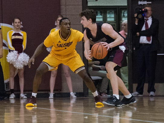 Salisbury University guard Gary Briddell (5) defends