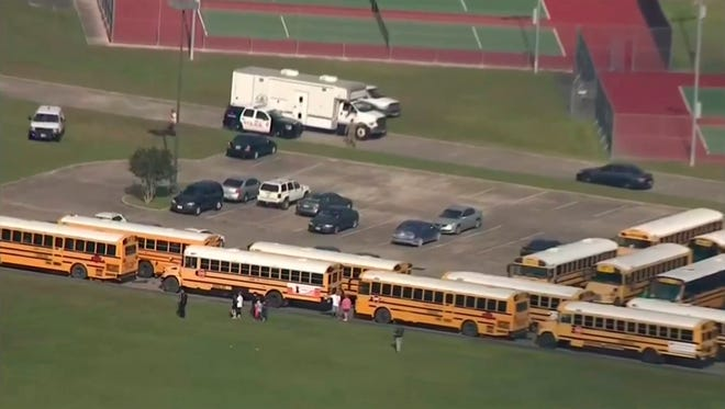 In this image taken from video law enforcement officers respond to a high school near Houston after an active shooter was reported on campus, Friday, May 18, 2018, in Santa Fe, Texas. The Santa Fe school district issued an alert Friday morning saying Santa Fe High School has been placed on lockdown. (KTRK-TV ABC13 via AP)