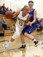 Waupun's Danielle Hopp drives to the basket during