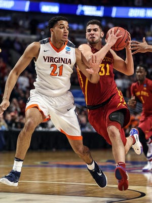 Iowa State's Georges Niang (31) drives to the basket as Virginia's Isaiah Wilkins defends Friday. Niang finished with 30 points but was charged with four fouls, including a controversial fourth.