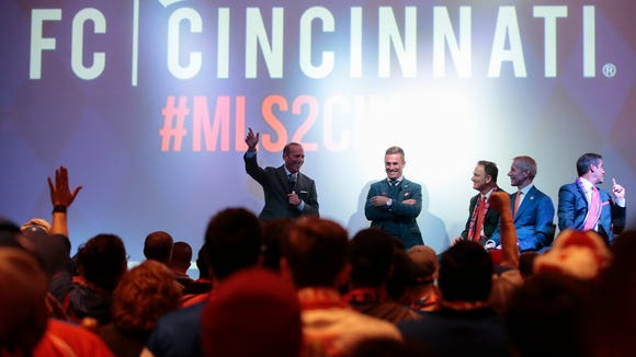 Major League Soccer Commissioner Don Garber takes questions from supporters of Futbol Club Cincinnati at the Woodward Theater in Over-the-Rhine on Tuesday.