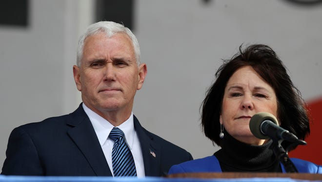Vice President Mike Pence listens as his wife Karen Pence speaks at the March for Life on the National Mall in Washington, Friday, Jan. 27, 2017. (AP Photo/Manuel Balce Ceneta) ORG XMIT: DCMC105