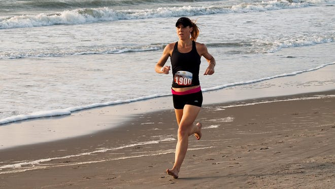 Kristen Klein, seen here running at the USA Beach Running Championships last May in Cocoa Beach, finished first among women and third overall in the barefoot division of the 10K race at 46 minutes, 9 seconds.