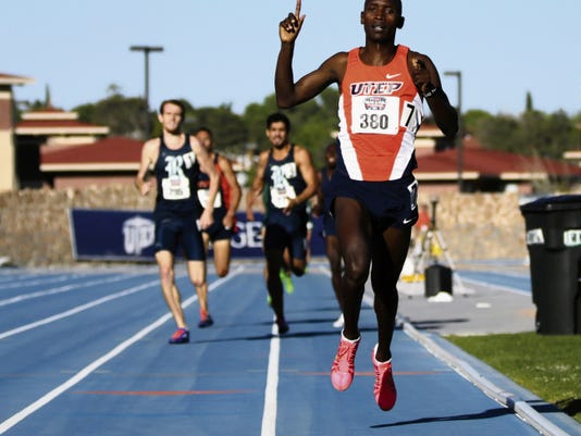 UTEP's Cosmas Boit raises his hand in victory as he prepares to cross the finish line in first place in the men's 800-meter event at the Conference USA Track and Field Championships on Sunday at Kidd Field.