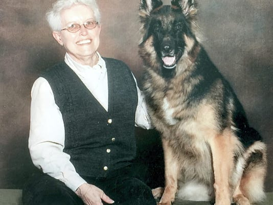 """Nadine Miller with her German Shepherd, Frieden, which means """"peace"""" in German."""