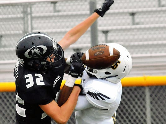 Jaime Guzman for the Sun-News   Onate cornerback Zach Puricelli (33) breaks up an attempted catch by a Hobbs receiver during first half action Saturday afternoon at the Field of Dreams.
