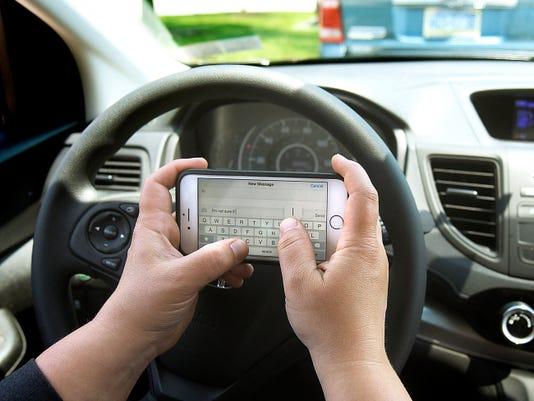 Texting and driving illustration. Tuesday, June 9, 2015. Bill Kalina photo illustration - bkalina@yorkdispatch.com