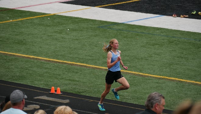 Lansing Catholic's Olivia Theis won the 1,600- and 3,200-meter runs at the Division 3 state finals Saturday, June 3, 2017.