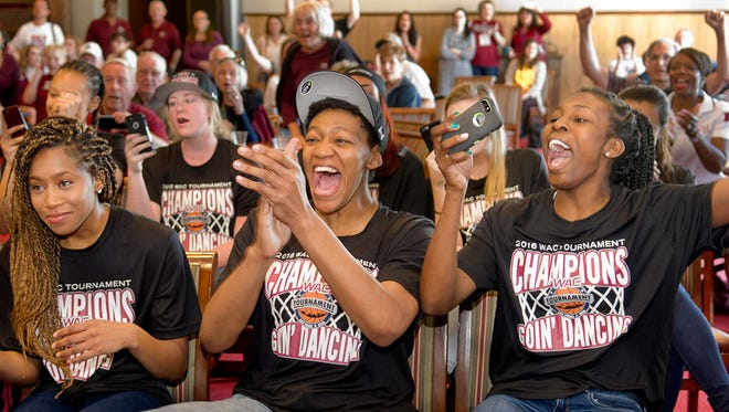 New Mexico State's, and Western Athletic Conference Tournament MVP, Sasha Weber, right, and her teammates Zaire Williams, left, and Tyesha Taylor, center, react to their NCAA tournament opponent Monday night in the Stan Fulton Center. The Aggies will play No. 2-seeded Arizona State in Tempe on Friday.